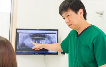 口腔内状態と治療計画の説明